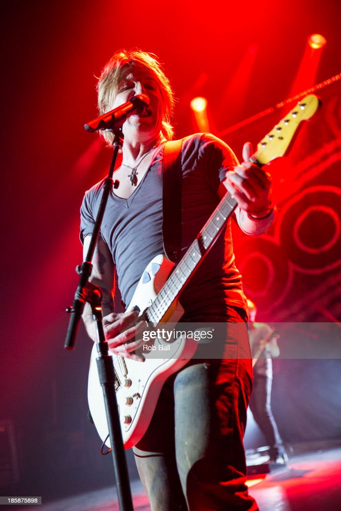 <a gi-track='captionPersonalityLinkClicked' href=/galleries/search?phrase=John+Rzeznik&family=editorial&specificpeople=220876 ng-click='$event.stopPropagation()'>John Rzeznik</a> of Goo Goo Dolls performs on stage at Hammersmith Apollo on October 25, 2013 in London, England.