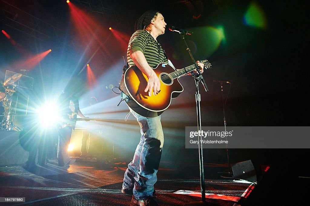 <a gi-track='captionPersonalityLinkClicked' href=/galleries/search?phrase=John+Rzeznik&family=editorial&specificpeople=220876 ng-click='$event.stopPropagation()'>John Rzeznik</a> of Goo Goo Dolls performs on stage at Manchester Academy on October 16, 2013 in Manchester, England.