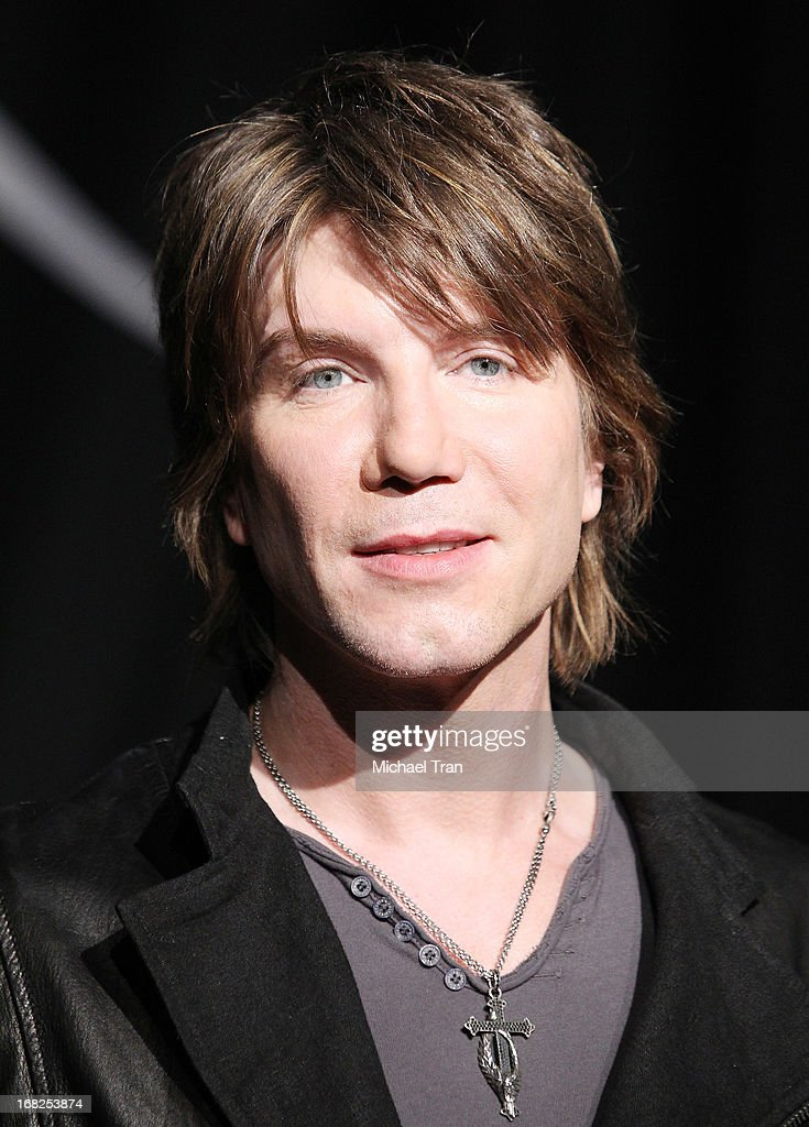 <a gi-track='captionPersonalityLinkClicked' href=/galleries/search?phrase=John+Rzeznik&family=editorial&specificpeople=220876 ng-click='$event.stopPropagation()'>John Rzeznik</a> of the <a gi-track='captionPersonalityLinkClicked' href=/galleries/search?phrase=Goo+Goo+Dolls&family=editorial&specificpeople=778803 ng-click='$event.stopPropagation()'>Goo Goo Dolls</a> inducted into Guitar Center's historic RockWalk held at Guitar Center on May 7, 2013 in Hollywood, California.