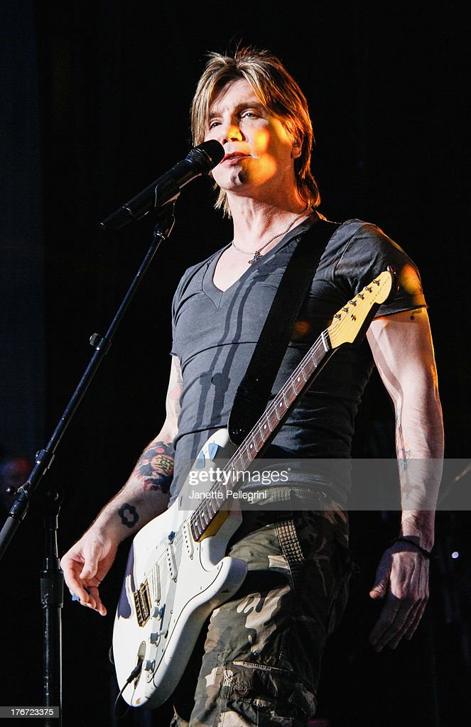 <a gi-track='captionPersonalityLinkClicked' href=/galleries/search?phrase=John+Rzeznik&family=editorial&specificpeople=220876 ng-click='$event.stopPropagation()'>John Rzeznik</a> of the Goo Goo Dolls performs at Nikon at Jones Beach Theater on August 17, 2013 in Wantagh, New York.