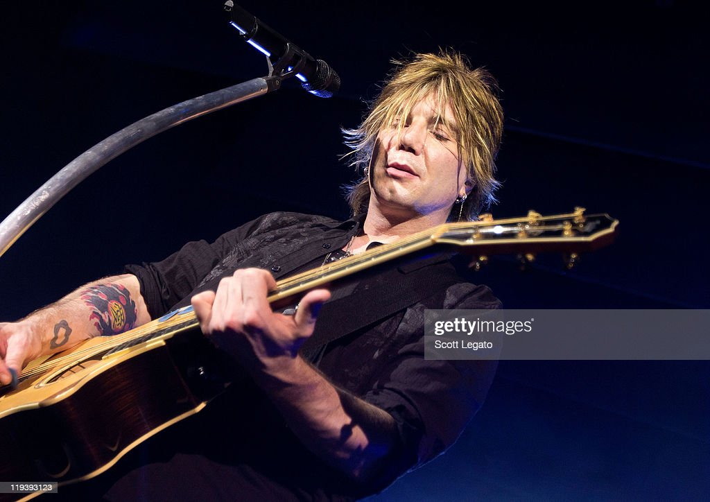 <a gi-track='captionPersonalityLinkClicked' href=/galleries/search?phrase=John+Rzeznik&family=editorial&specificpeople=220876 ng-click='$event.stopPropagation()'>John Rzeznik</a> of The Goo Goo Dolls performs at the Meadow Brook Music Festival on July 17, 2011 in Rochester, Michigan.