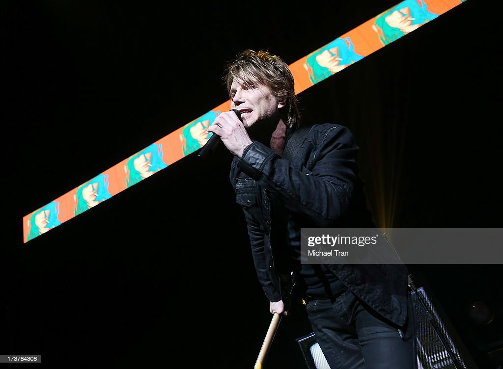 <a gi-track='captionPersonalityLinkClicked' href=/galleries/search?phrase=John+Rzeznik&family=editorial&specificpeople=220876 ng-click='$event.stopPropagation()'>John Rzeznik</a> of the <a gi-track='captionPersonalityLinkClicked' href=/galleries/search?phrase=Goo+Goo+Dolls&family=editorial&specificpeople=778803 ng-click='$event.stopPropagation()'>Goo Goo Dolls</a> performs onstage at Gibson Amphitheatre on July 17, 2013 in Universal City, California.