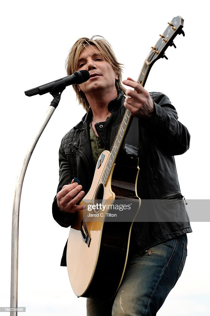 John Rzeznik of the Goo Goo Dolls performs prior to the start of the NASCAR Sprint Cup Series Bank of America 500 at Charlotte Motor Speedway on October 12, 2013 in Concord, North Carolina.
