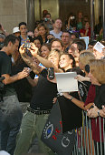John Rzeznik poses for photo with fan during Goo Goo Dolls Perform on 'The Today Show' Summer Concert Series July 25 2003 at NBC Studios Rockefeller...