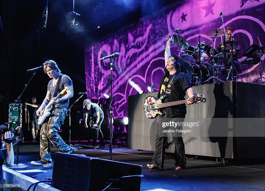 John Rzeznik, Robby Takac and Mike Malinin of the Goo Goo Dolls perform at Nikon at Jones Beach Theater on August 17, 2013 in Wantagh, New York.
