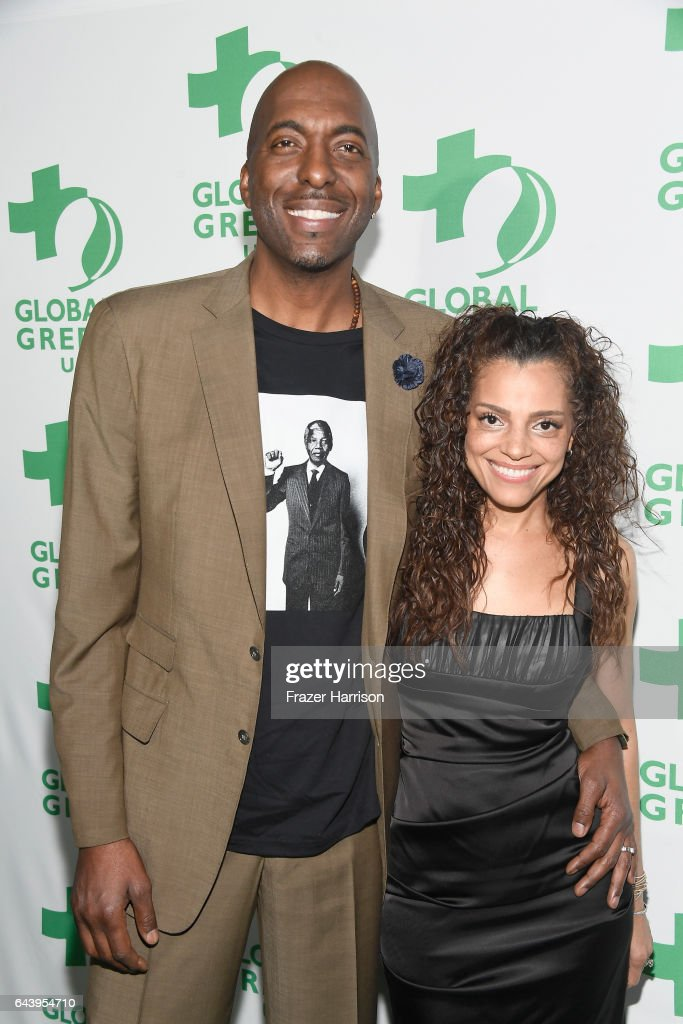 John Salley and Natasha Duffy attend the 14th Annual Global Green Pre Oscar Party at TAO Hollywood on February 22, 2017 in Los Angeles, California.