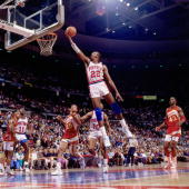 John Salley of the Detroit Pistons attempts a layup against the Atlanta Hawks during an NBA game played at the Palace of Auburn Hills in Detroit...