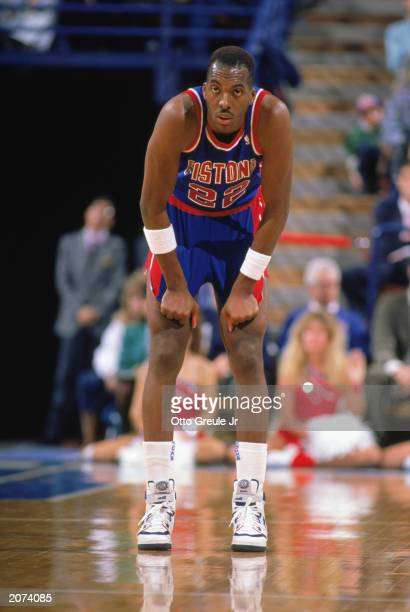 John Salley of the Detroit Pistons waits for play during a game in the 19881989 NBA season