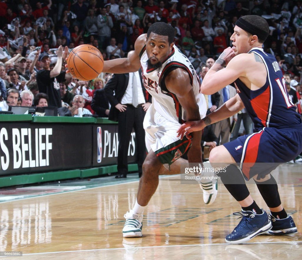 John Salmons of the Milwaukee Bucks drives against Mike Bibby of the Atlanta Hawks in Game Four of the Eastern Conference Quarterfinals during the...
