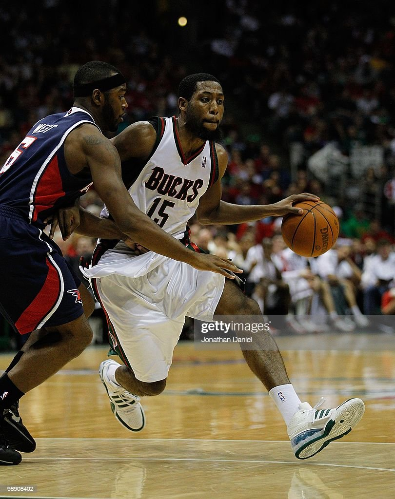 John Salmons of the Milwaukee Bucks drives around Mario West of the Atlanta Hawks in Game Six of the Eastern Conference Quarterfinals during the 2010...