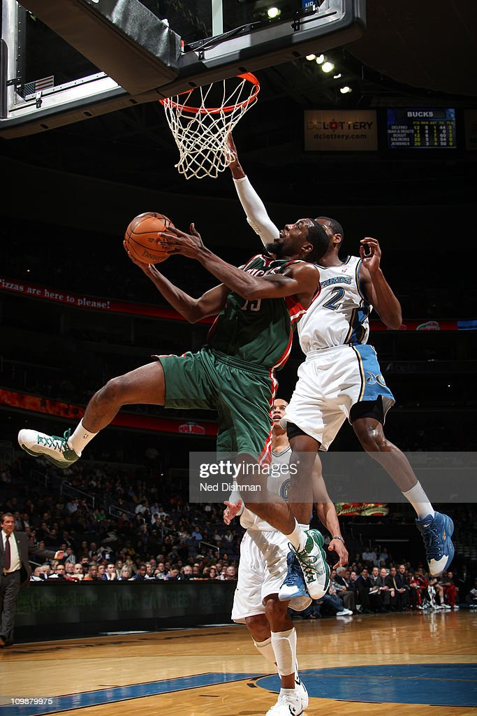 John Salmons of the Milwaukee Bucks shoots against John Wall of the Washington Wizards during the game at the Verizon Center on March 8 2011 in...