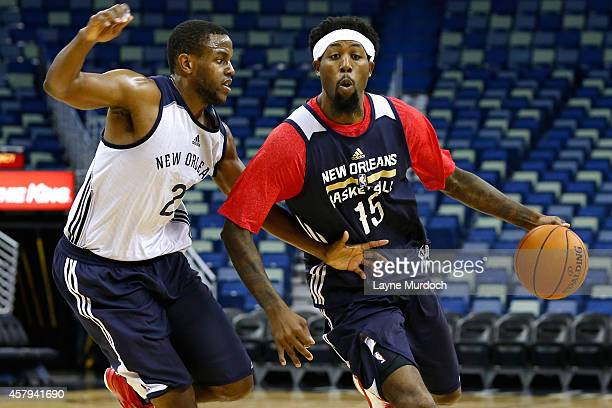John Salmons of the New Orleans Pelicans dribbles by Darius Miller as the team holds an open practice for fans on October 25 2014 at the Smoothie...