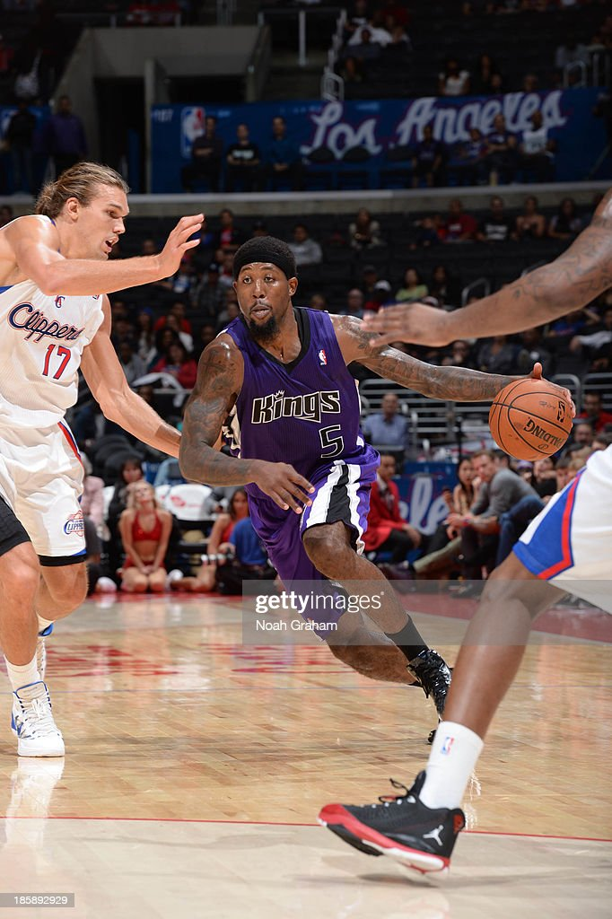 <a gi-track='captionPersonalityLinkClicked' href=/galleries/search?phrase=John+Salmons&family=editorial&specificpeople=202524 ng-click='$event.stopPropagation()'>John Salmons</a> #5 of the Sacramento Kings drives against Lou Amundson #17 of the Los Angeles Clippers at Staples Center on October 25, 2013 in Los Angeles, California.