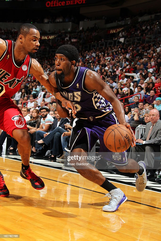 <a gi-track='captionPersonalityLinkClicked' href=/galleries/search?phrase=John+Salmons&family=editorial&specificpeople=202524 ng-click='$event.stopPropagation()'>John Salmons</a> #5 of the Sacramento Kings drives baseline against <a gi-track='captionPersonalityLinkClicked' href=/galleries/search?phrase=Rashard+Lewis&family=editorial&specificpeople=201713 ng-click='$event.stopPropagation()'>Rashard Lewis</a> #9 of the Miami Heat on February 26, 2013 at American Airlines Arena in Miami, Florida.