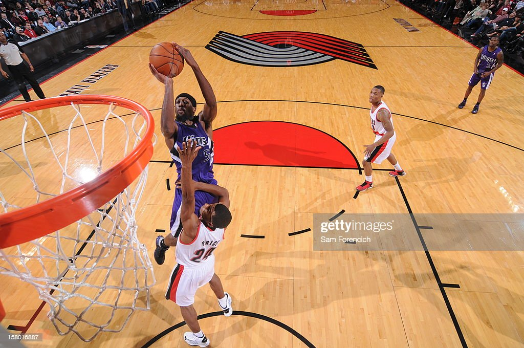 <a gi-track='captionPersonalityLinkClicked' href=/galleries/search?phrase=John+Salmons&family=editorial&specificpeople=202524 ng-click='$event.stopPropagation()'>John Salmons</a> #5 of the Sacramento Kings goes to the basket against <a gi-track='captionPersonalityLinkClicked' href=/galleries/search?phrase=Ronnie+Price&family=editorial&specificpeople=654750 ng-click='$event.stopPropagation()'>Ronnie Price</a> #24 of the Portland Trail Blazers during the game between the Sacramento Kings and the Portland Trail Blazers on December 8, 2012 at the Rose Garden Arena in Portland, Oregon.