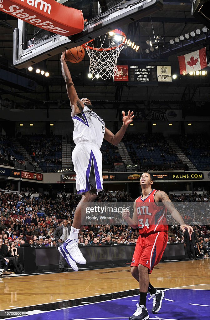 John Salmons #5 of the Sacramento Kings goes up for the dunk against Devin Harris #34 of the Atlanta Hawks on November 16, 2012 at Sleep Train Arena in Sacramento, California.