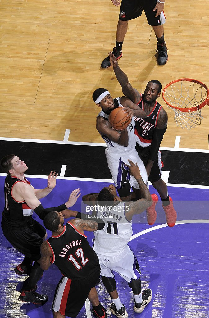 <a gi-track='captionPersonalityLinkClicked' href=/galleries/search?phrase=John+Salmons&family=editorial&specificpeople=202524 ng-click='$event.stopPropagation()'>John Salmons</a> #5 of the Sacramento Kings goes up for the shot against <a gi-track='captionPersonalityLinkClicked' href=/galleries/search?phrase=J.J.+Hickson&family=editorial&specificpeople=4226173 ng-click='$event.stopPropagation()'>J.J. Hickson</a> #21 of the Portland Trail Blazers on December 23, 2012 at Sleep Train Arena in Sacramento, California.