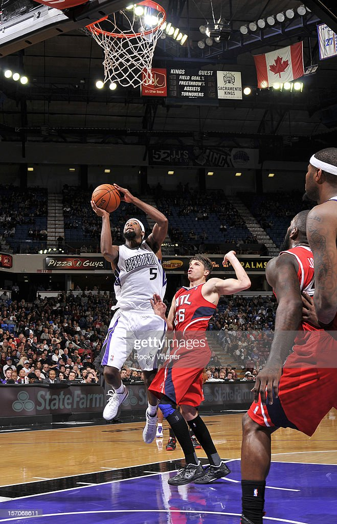 John Salmons #5 of the Sacramento Kings goes up for the shot against Kyle Korver #26 of the Atlanta Hawks on November 16, 2012 at Sleep Train Arena in Sacramento, California.