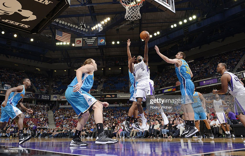 <a gi-track='captionPersonalityLinkClicked' href=/galleries/search?phrase=John+Salmons&family=editorial&specificpeople=202524 ng-click='$event.stopPropagation()'>John Salmons</a> #5 of the Sacramento Kings lays the ball up against the New Orleans Hornets on April 10, 2013 at Sleep Train Arena in Sacramento, California.
