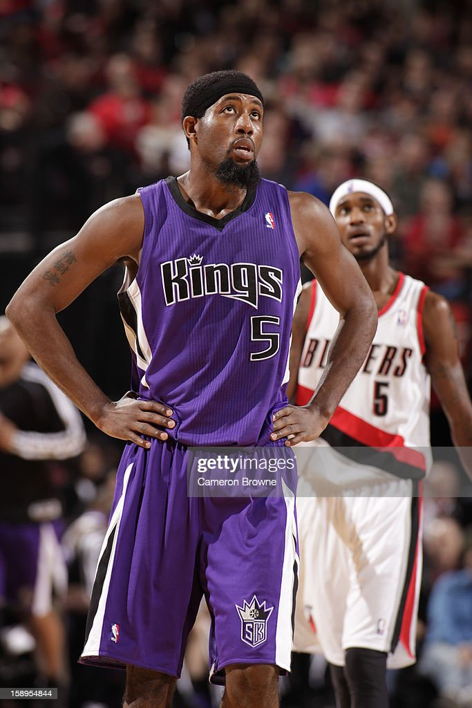 <a gi-track='captionPersonalityLinkClicked' href=/galleries/search?phrase=John+Salmons&family=editorial&specificpeople=202524 ng-click='$event.stopPropagation()'>John Salmons</a> #5 of the Sacramento Kings looks at the scoreboard during the game against the Portland Trail Blazers on December 26, 2012 at the Rose Garden Arena in Portland, Oregon.
