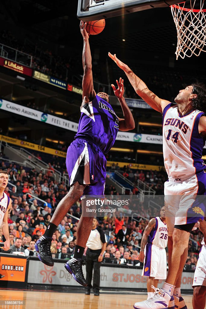 <a gi-track='captionPersonalityLinkClicked' href=/galleries/search?phrase=John+Salmons&family=editorial&specificpeople=202524 ng-click='$event.stopPropagation()'>John Salmons</a> #5 of the Sacramento Kings puts up a shot over <a gi-track='captionPersonalityLinkClicked' href=/galleries/search?phrase=Luis+Scola&family=editorial&specificpeople=2464749 ng-click='$event.stopPropagation()'>Luis Scola</a> #14 of the Phoenix Suns on December 17, 2012 at U.S. Airways Center in Phoenix, Arizona.