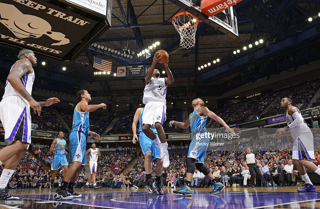 <a gi-track='captionPersonalityLinkClicked' href=/galleries/search?phrase=John+Salmons&family=editorial&specificpeople=202524 ng-click='$event.stopPropagation()'>John Salmons</a> #5 of the Sacramento Kings shoots against Eric Gordon #10 of the New Orleans Hornets on April 10, 2013 at Sleep Train Arena in Sacramento, California.