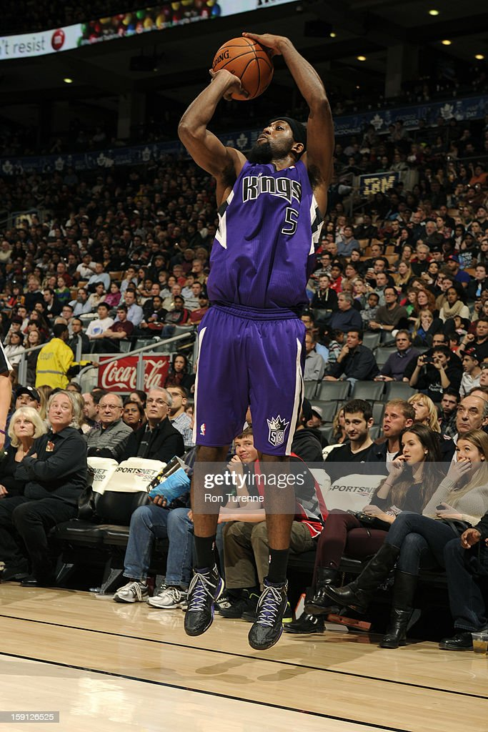 <a gi-track='captionPersonalityLinkClicked' href=/galleries/search?phrase=John+Salmons&family=editorial&specificpeople=202524 ng-click='$event.stopPropagation()'>John Salmons</a> #5 of the Sacramento Kings takes a shot against the Toronto Raptors on January 4, 2013 at the Air Canada Centre in Toronto, Ontario, Canada.