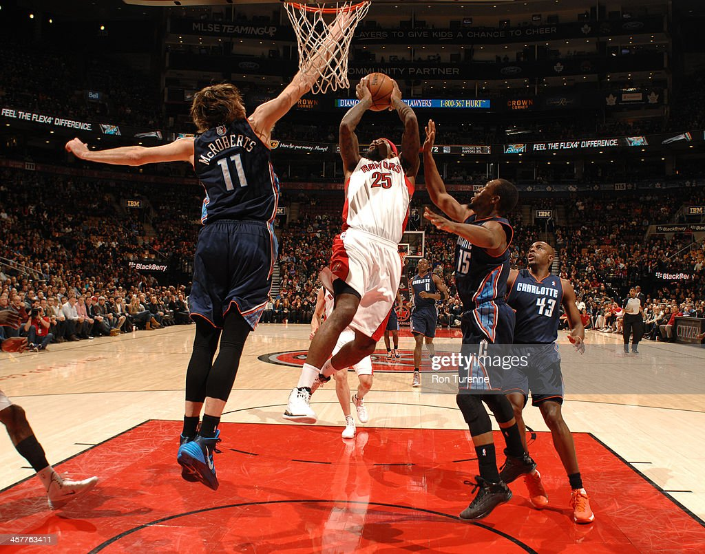 John Salmons of the Toronto Raptors drives to the basket against the Charlotte Bobcats on December 18 2013 at the Air Canada Centre in Toronto...