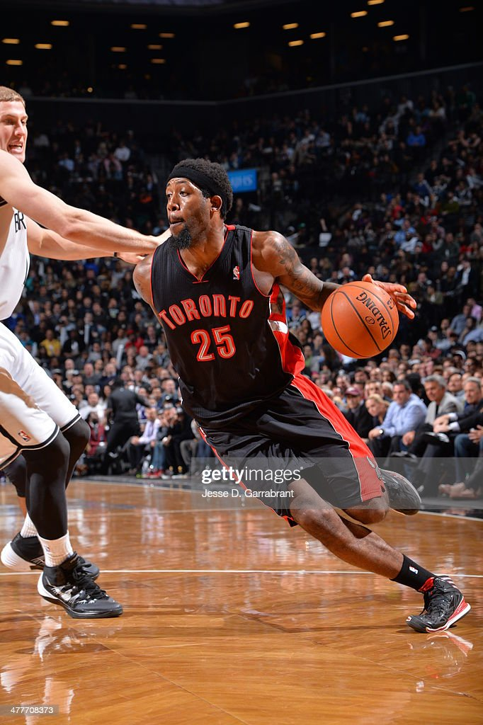 John Salmons of the Toronto Raptors drives to the basket against the Brooklyn Nets on March 10 2014 at the Barclays Center in Brooklyn New York NOTE...