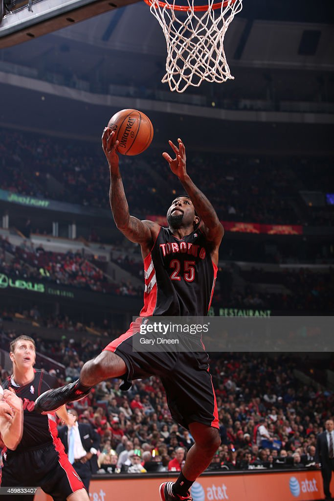 John Salmons of the Toronto Raptors goes to the basket during the game against the Chicago Bulls on December 31 2013 at the United Center in Chicago...