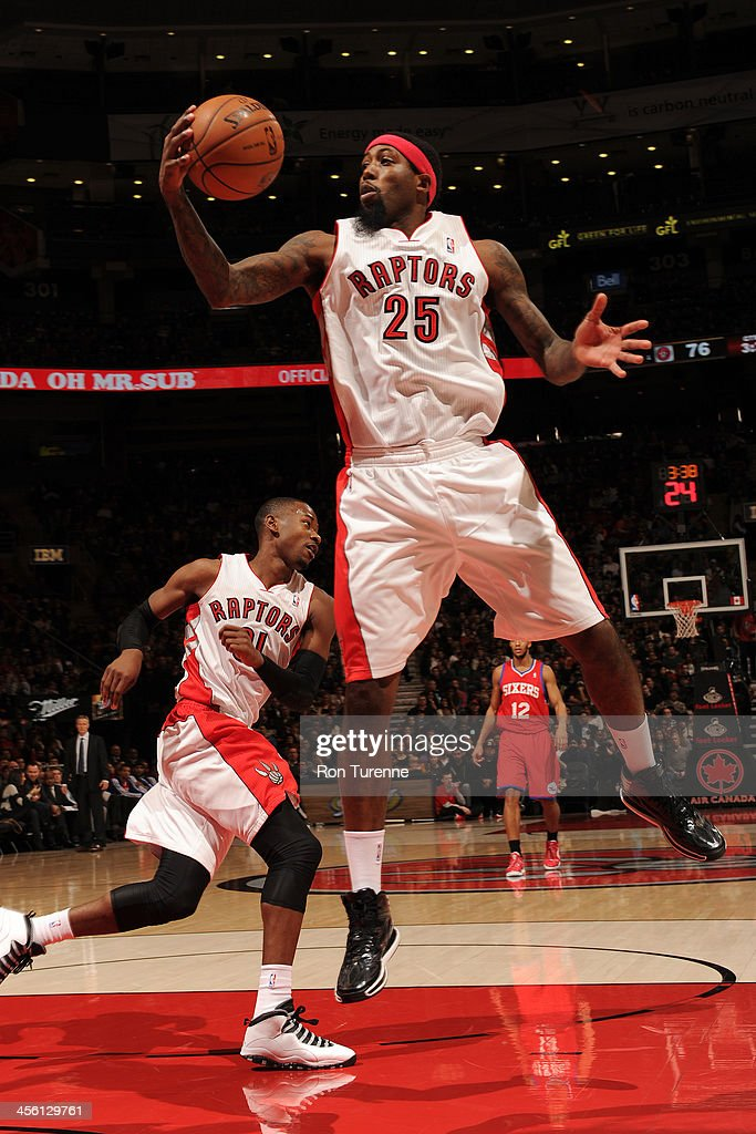 John Salmons of the Toronto Raptors grabs a rebound against the Philadelphia 76ers on December 13 2013 at the Air Canada Centre in Toronto Ontario...