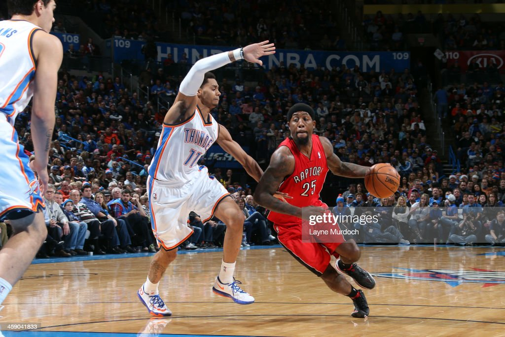 John Salmons of the Toronto Raptors handles the ball against Jeremy Lamb of the Oklahoma City Thunder on December 22 2013 at the Chesapeake Energy...