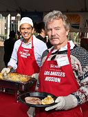 John Savage and Antonio Villaraigosa are seen at the annual Los Angeles Mission Christmas Dinner on December 24 2015 in Los Angeles California