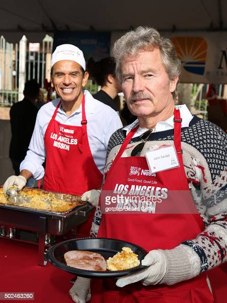 John Savage and Antonio Villaraigosa are seen at the annual Los Angeles Mission Christmas Dinner on December 24 2015 in Los Angeles California