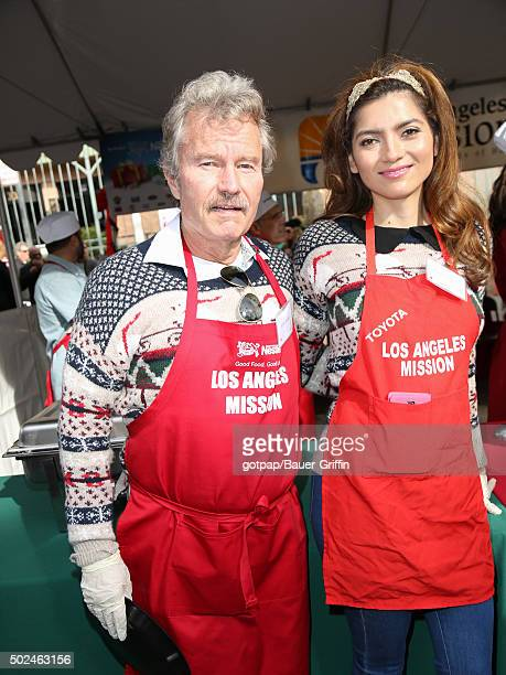 John Savage and Blanca Blanco are seen at the annual Los Angeles Mission Christmas Dinner on December 24 2015 in Los Angeles California