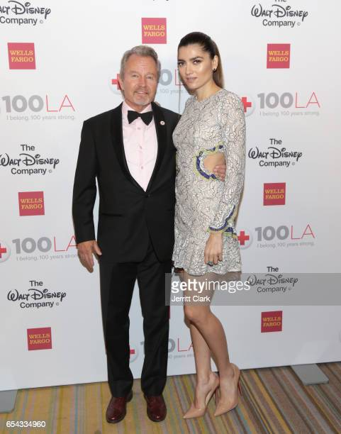 John Savage and Blanca Blanco attend the American Red Cross Centennial Celebration To Honor Disney As 'Humanitarian Company Of The Year' at the...