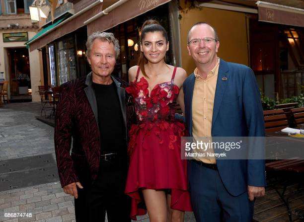 John Savage Blanca Blanco and Col Needham attend IMDb's 2017 Cannes dinner party at Table 22 on May 22 2017 in Cannes France