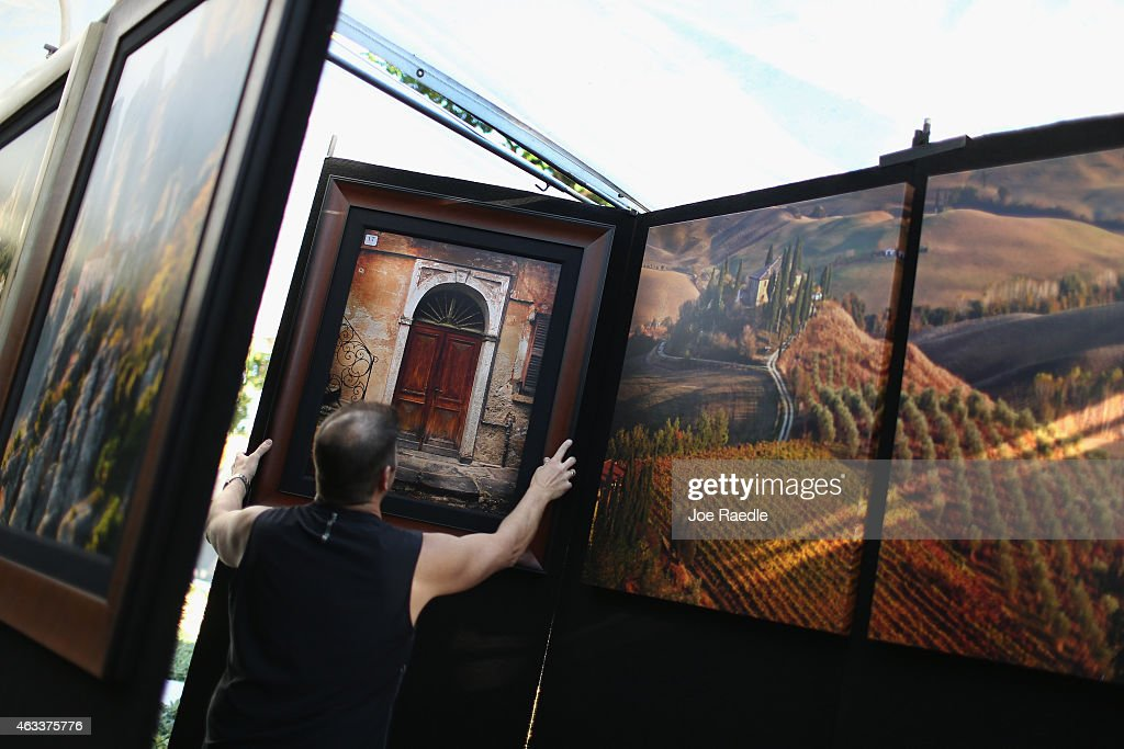 John Scanlan puts his ' Windows to the World' photographs on display for the opening of the 52nd Annual Coconut Grove Arts Festival on February 13...