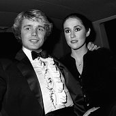 John Schneider and Tawny Little attend First Annual American Video Awards on April 6 1983 at the Beverly Theater in Beverly Hills California