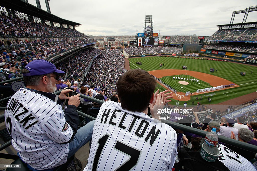 John Schwartz and his son Scott take in the pregame festivites as the San Diego Padres face the Colorado Rockies during Opening Day at Coors Field on April 5, 2013 in Denver, Colorado. The Rockies defeated the Padres 5-2.
