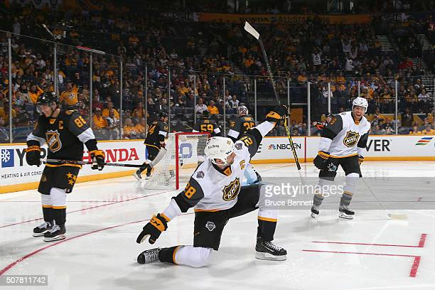 John Scott of the Arizona Coyotes celebrates after scoring a goal in the first period of the Western Conference Semifinal Game between the Central...