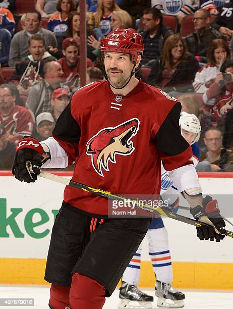 John Scott of the Arizona Coyotes gets ready during a faceoff against the Edmonton Oilers at Gila River Arena on November 12 2015 in Glendale Arizona