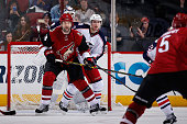 John Scott of the Arizona Coyotes sets up in front of Ryan Murray of the Columbus Blue Jackets during the NHL game at Gila River Arena on December 17...