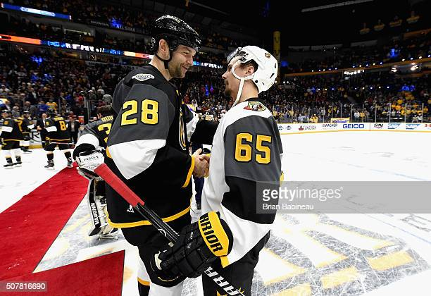 John Scott of the Arizona Coyotes shakes hands with Erik Karlsson of the Ottawa Senators after the 2016 Honda NHL AllStar Final Game between the...