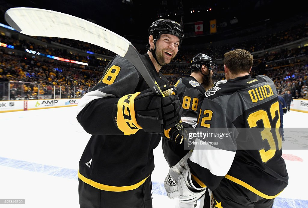 John Scott of the Arizona Coyotes smiles after his team won the 2016 Honda NHL AllStar Final Game between the Eastern Conference and the Western...