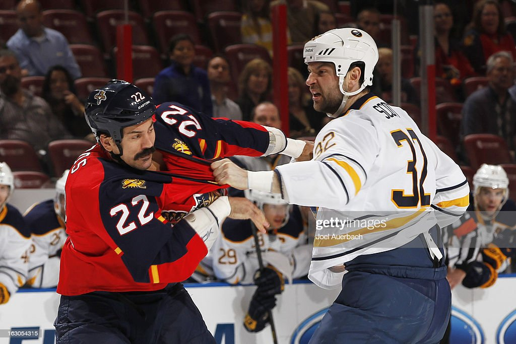 John Scott #32 of the Buffalo Sabres and George Parros #22 of the Florida Panthers fight during the first period at the BB&T Center on February 28, 2013 in Sunrise, Florida. The Sabres defeated the Panthers 4-3 in a shootout.