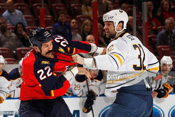 John Scott of the Buffalo Sabres and George Parros of the Florida Panthers fight during the first period at the BBT Center on February 28 2013 in...