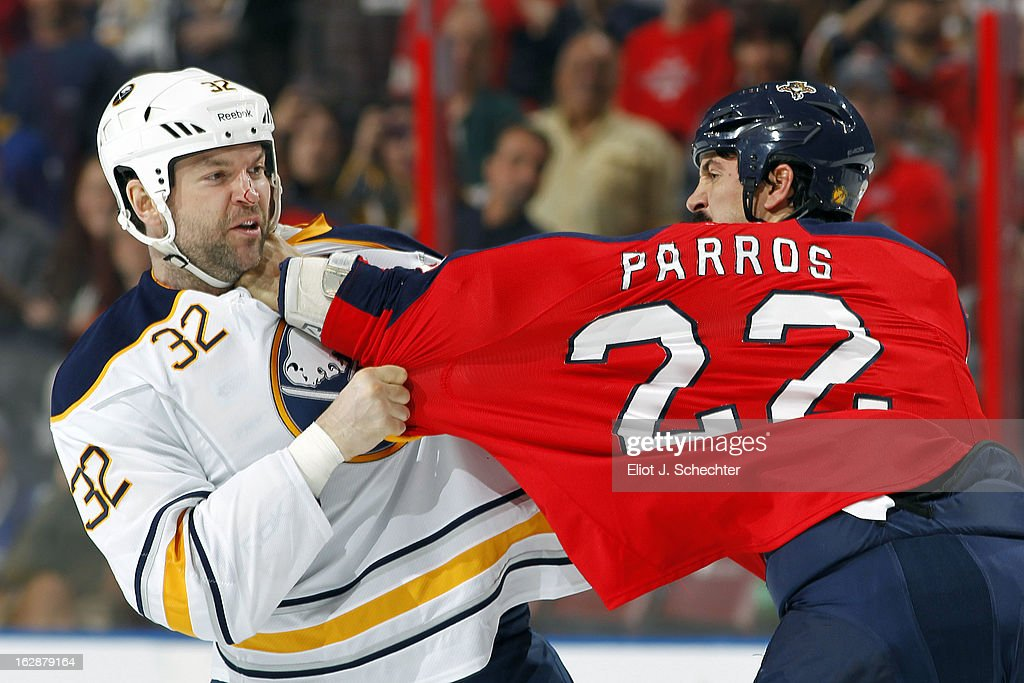 John Scott #32 of the Buffalo Sabres fights with George Parros #22 of the Florida Panthers at the BB&T Center on February 28, 2013 in Sunrise, Florida.
