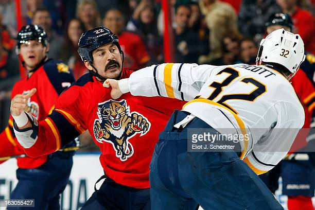 John Scott of the Buffalo Sabres fights with George Parros of the Florida Panthers at the BBT Center on February 28 2013 in Sunrise Florida