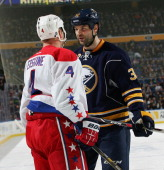 John Scott of the Buffalo Sabres has words with John Erskine of the Washington Capitals on January 28 2014 at the First Niagara Center in Buffalo New...